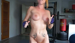 ginger girl with fit body doing some more workout on webcam